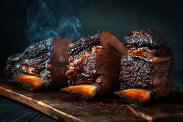 Cut a large piece of smoked beef brisket to the ribs with a dark crust. Classic Texas barbecue Wall mural
