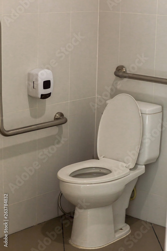 Empty Toilet For Background With Handrails The