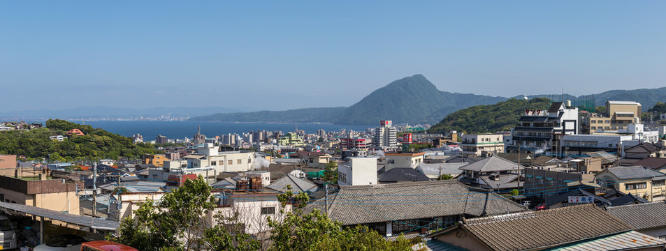 Panoramic view on Skyline of Beppu City and Bay. Town Oita in the Background. Beppu, Oita, Japan, Asia.