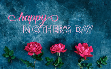 Happy Mother's Day background with pink roses from top view.