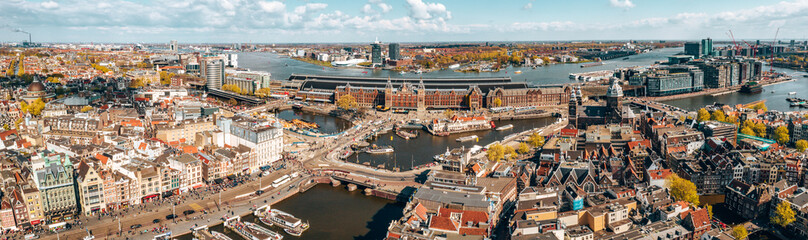 Wall Mural - Beautiful aerial Amsterdam view from above with many narrow canals, streets and architectures.