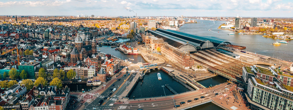 Beautiful aerial Amsterdam view from above with many narrow canals, streets and architectures.