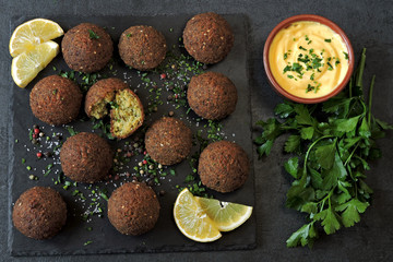 Canvas Prints Spices Falafel with sauce, spices and herbs. Middle Eastern cuisine.