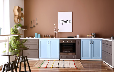 Modern interior of kitchen with stylish furniture