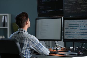 Fototapeta Male programmer working in office
