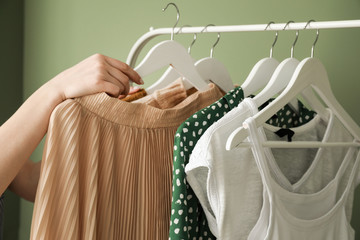 Woman choosing clothes in dressing room