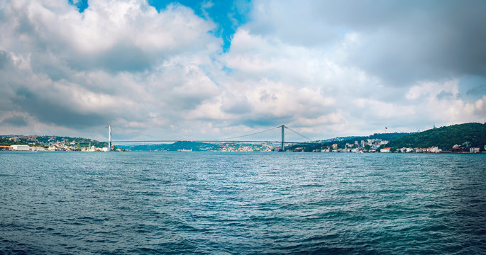 Bosphorus passage in Istanbul with first bridge on Ortakoy called 15 July Martyrs Bridge connecting Europe and Asia