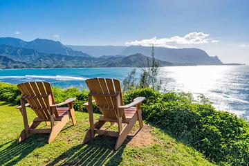 lounging chairs overlooking Hanalei Bay and the Na Pali coast Princeville Kauai Hawaii USA