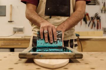 Hands putting logotype on desk