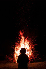 Silhouette of a man against the background of a fire flame