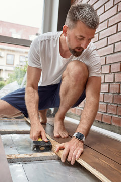 Man attacking floor wooden planks