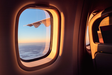 Sun streaming in the window during a sunrise flight in a small plane