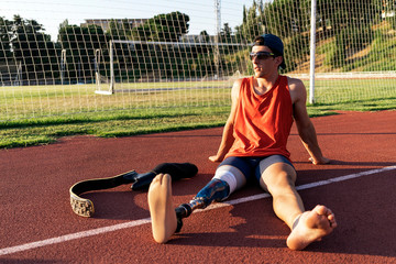 Portrait of disabled man athlete with leg prosthesis