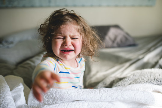 Little girl upset about waking up.
