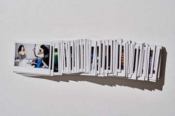 Line of polaroid photos of girlfriends having fun.
