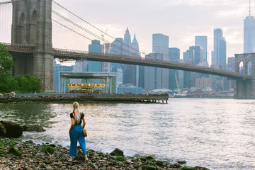 Girl walking the shore of the Hudson River