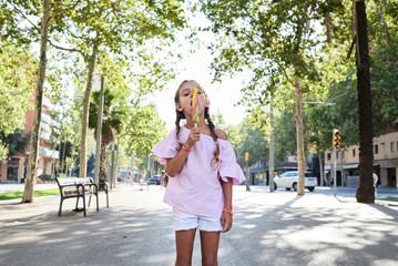 Little girl enjoying icecream in summer.
