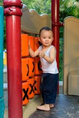 Asian baby boy in playground