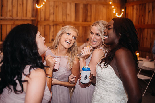 Bridesmaids and Bride Partying at Wedding
