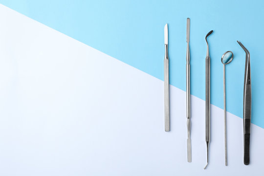 Set of different dentist tools on color background, flat lay. Space for text