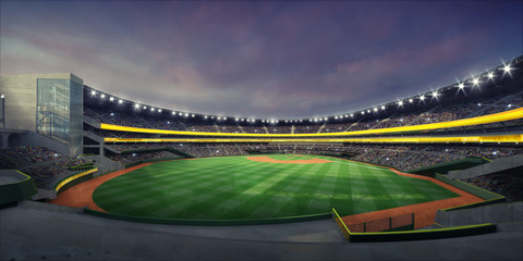 General view of illuminated baseball stadium and grass playground from the grandstand