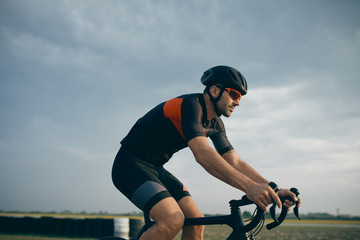Cyclist racing in the race track.