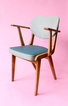 Vintage sixties chair on pink background