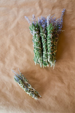 freshly bound sage bundles to dry and become smudge sticks
