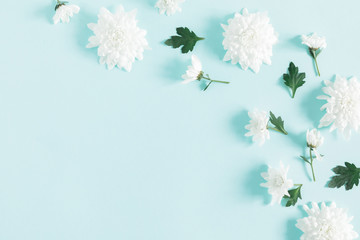Beautiful flowers composition. White flowers on pastel blue background. Valentines Day, Easter, Birthday, Happy Women's Day, Mother's day. Flat lay, top view, copy space