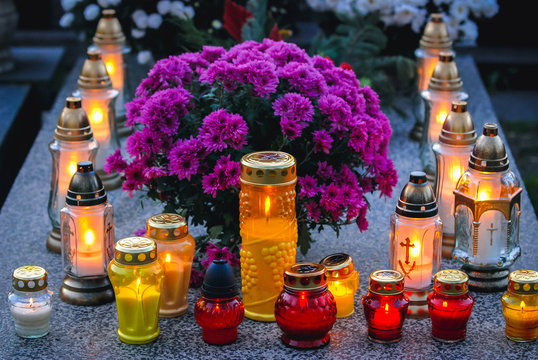 Candles on a grave in Wola Cemetery in Warsaw city, Poland during All Saints Day