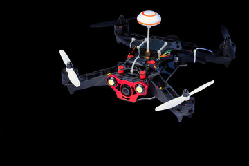 Dron, quadro copter Isolated on black background, closeup.