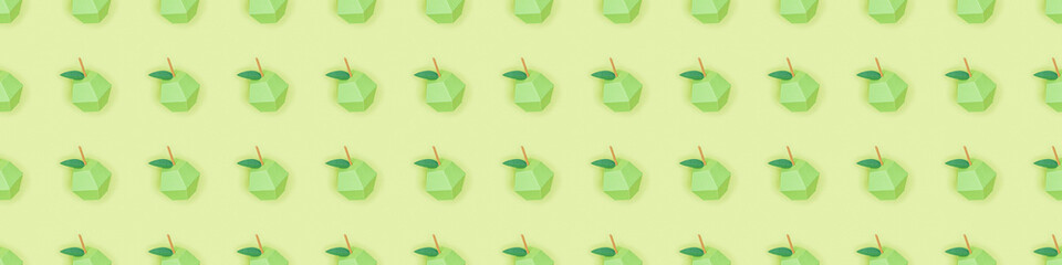 panoramic shot of pattern with handmade paper apples isolated on green