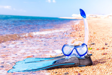 Mask and flippers. Snorkelling equipment and blue tropical resort sea