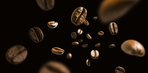 Papiers peints Café en grains Coffee beans in flight on a dark background
