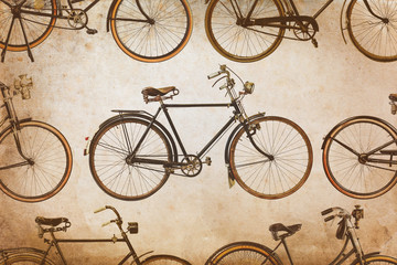 Different vintage rusted bicycles isolated on white