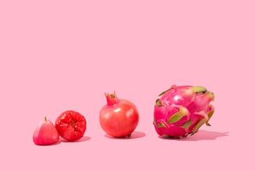 Exotic Tropical Fruits on Pink Background - Pomegranate, Pitaya, Dragonfruit, Jambu
