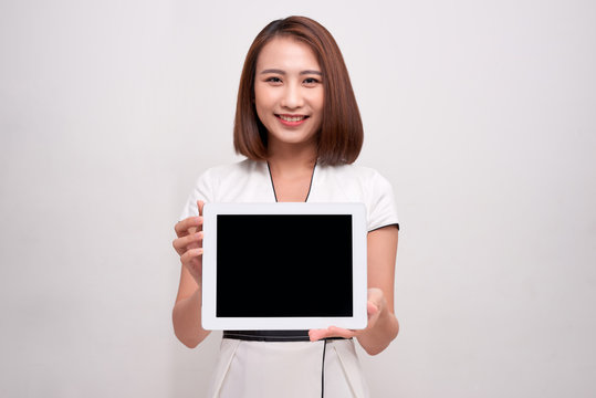 Asian business woman holding ipad tablet
