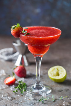 Ice Strawberry alcohol cocktail with lime and rum in a glass