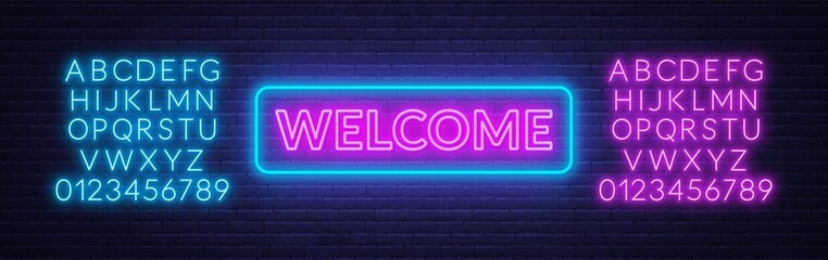 Neon sign welcome on on brick wall background. Neon alphabet.