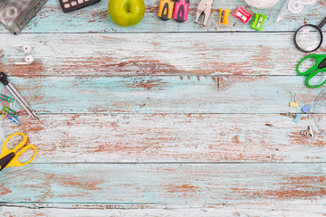 top view image of school supplies on wooden table.