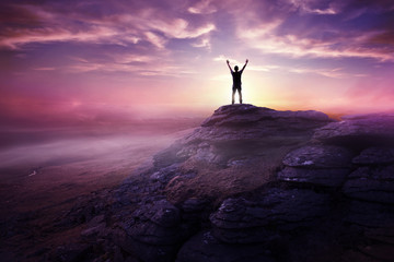 Fototapete - A man expressing freedom by reaching up to the sky as the sun sets in the distance. Hopes and dreams photo composite.