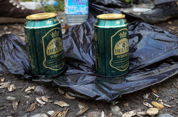 Cans of whiskey are seen next to the Tigris river, after alcohol was banned during the Islamic State militants' seizure of the city in Mosul