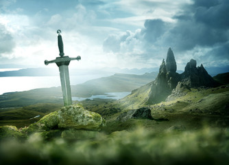 Fototapeta An ancient and mythical sword set against a dramatic landscape. Fantasy background 3d mixed media. obraz
