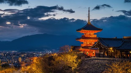 Wall Mural - Time lapse of Kyoto city with red pagoda at twilight, Japan. zoom in
