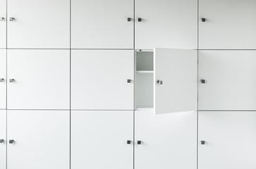 Empty white kitchen cabinet wall