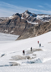 Greenland, Sermersooq, Kulusuk, Schweizerland Alps, group of people walking in snow
