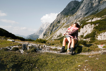 Austria, Tyrol, happy mother and daughter hugging in mountainscape