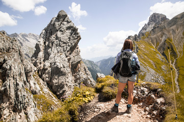 Austria, Tyrol, woman on a hiking trip in the mountains looking at view