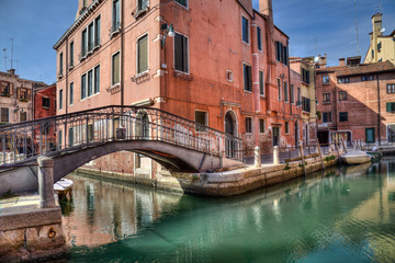 Small bridge and canal in Venice, Italy
