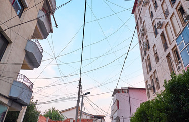 Wires on buildings in a residential area of Tirana, Albania